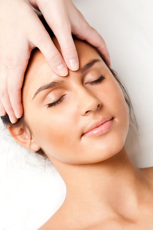 a woman getting craniosacral therepy