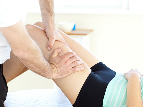 man massaging legs in lymphatic massage