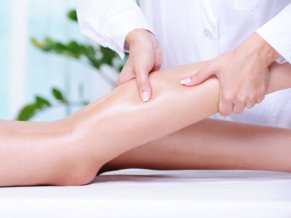 person massaging calve